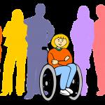 Grupo de diferentes personas con una mujer en silla de ruedas al frente